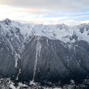 The Aiguilles Rouges tower above Chamonix.  Photo: Lily Pifferini- Carter